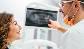 woman looking at x-ray with dentist