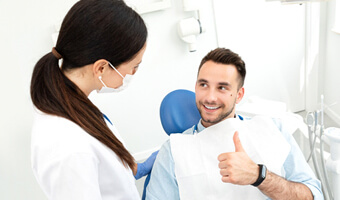 Male patient excited about his gum recontouring procedure