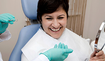 woman laughing with dentist